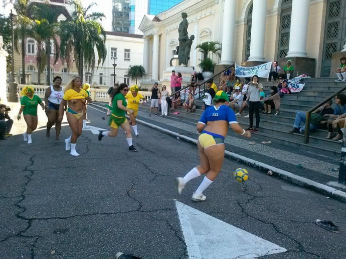 people playing soccer outside niteroi's city govt