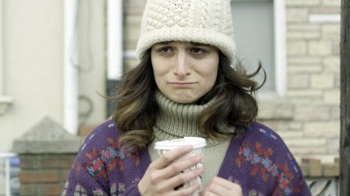 a still from obvious child of the main character looking glum