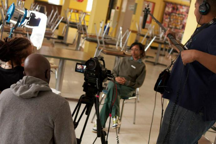 Patreese being interviewed by blair doroshwalther, with Daniel Patterson behind the camera, at Albion Correctional Facility. Image by Scott Gracheff