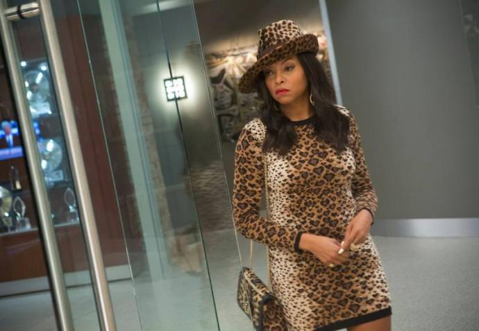 cookie, wearing a leopard print dress and hat