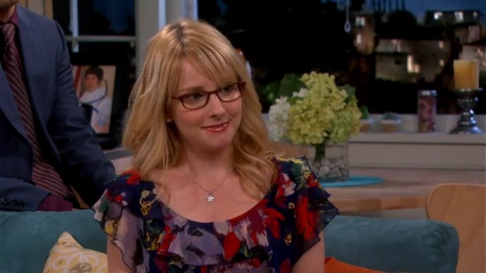 bernadette is a blonde woman with glasses