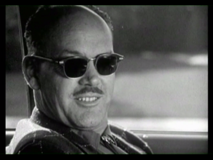 a man leering and wearing sunglasses