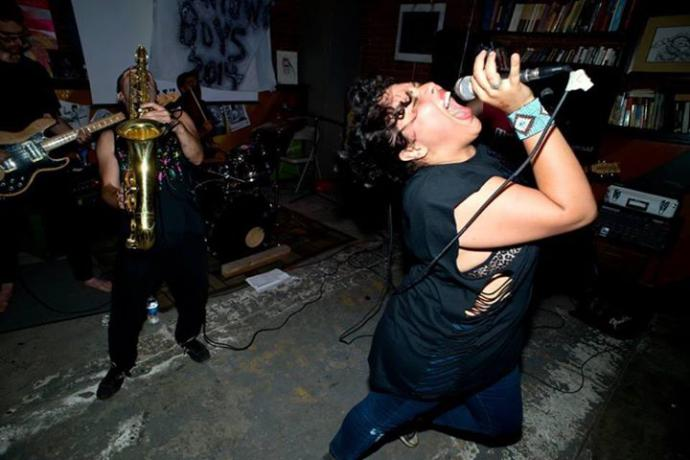 lead singer victoria ruiz backed by a saxophone