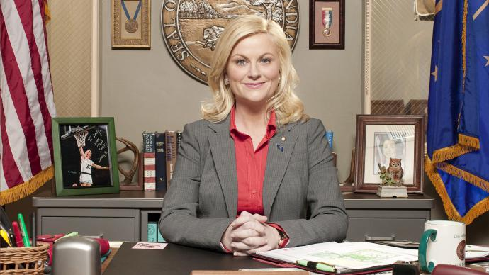 leslie knope, sitting at her desk