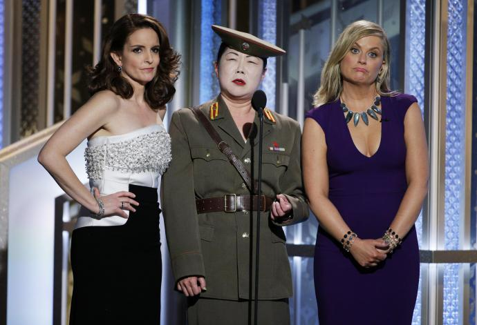 Margaret Cho dressed as a general standing between tina fey and amy poehler