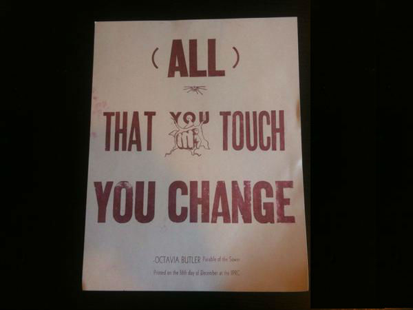 "a poster bearing the words ""all that you touch you change"""