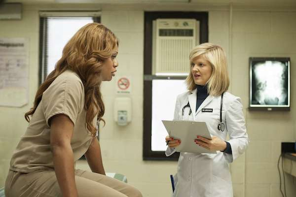 Laverne Cox's character sits in a doctors office in orange is the new black