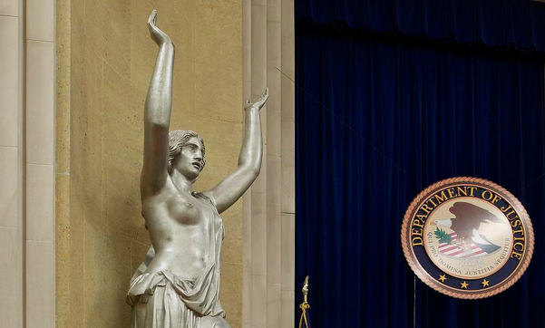 spirit of justice statue is a woman with her arms raised and one bare breast