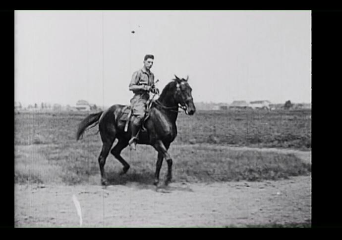 a man riding a horse