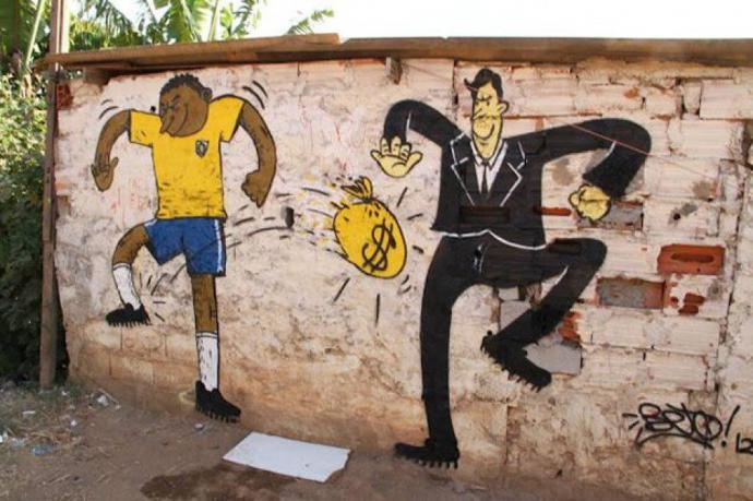 graffiti in brazil shows an athlete and rich man kicking money back and forth