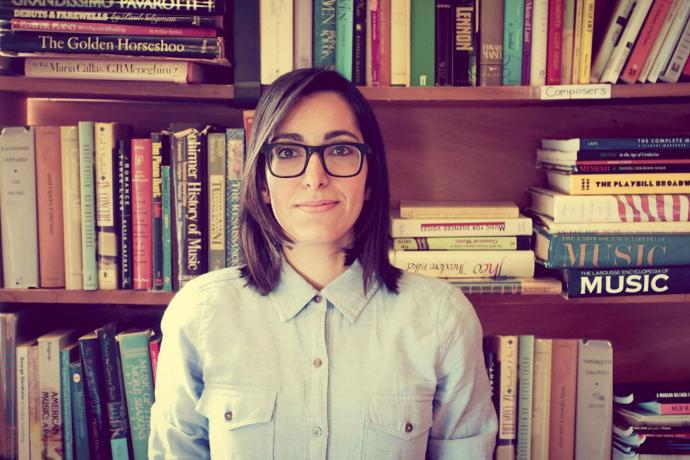 michelle chamuel in front of a bookcase