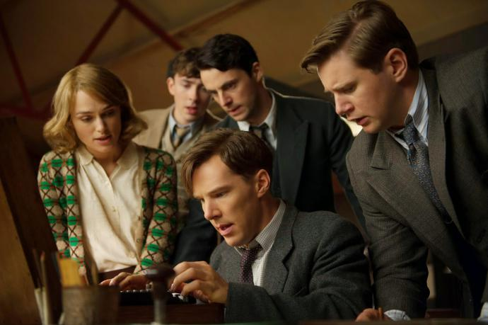 keira knightley and four men standing over typewriter in the imitation game