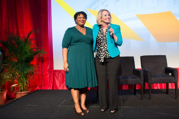 stacey abrams and another woman onstage