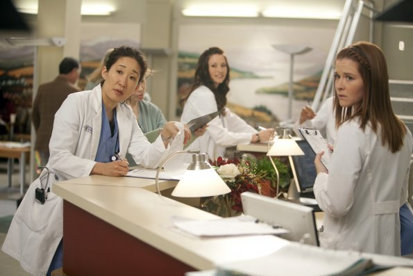 Yang and Kepner at the nursing station, looking surprised.
