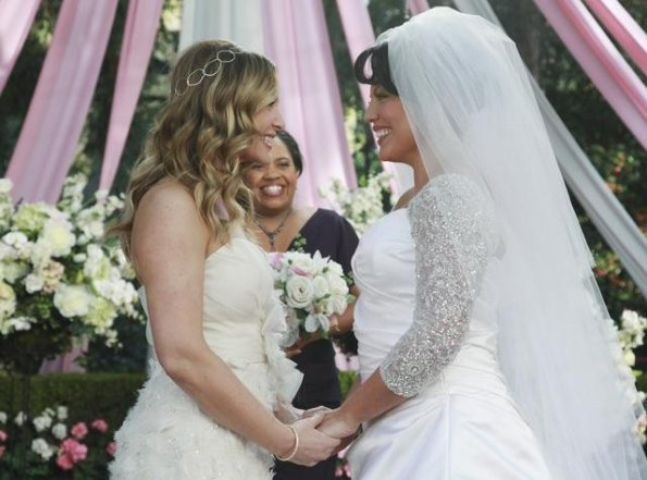 Callie and Arizona hold hands at the altar, gazing at each other. Bailey is in the background