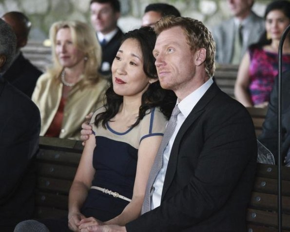 Doctors Yang and Hunt at the wedding, looking fancy.