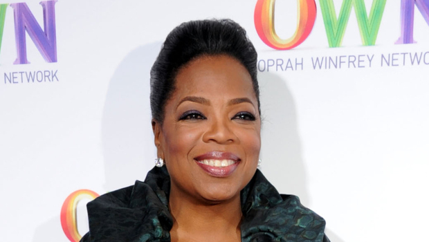 a head shot of Oprah Winfrey. She is wearing black and has her hair pulled up.