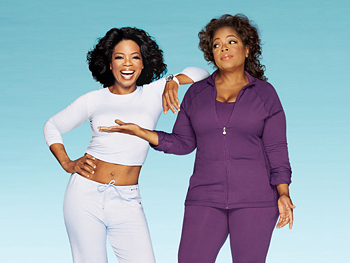 Present-day Oprah stands next to a cardboard cutout of an former, thinner Oprah. Both are wearing tracksuits.