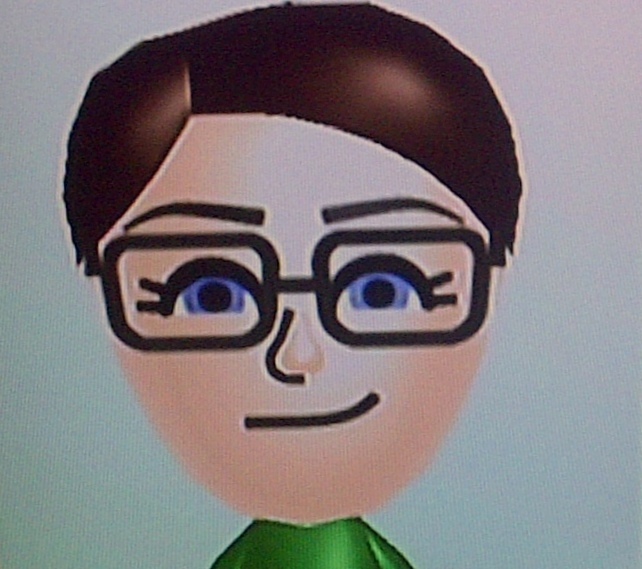 a Mii of Rachel Maddow, a white woman with short brown hair wearing glasses and a knowing smile