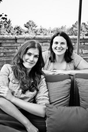 Cristen Conger and Molly Edmonds, hosts of Stuff Mom Never Told You, in black and white looking at the camera