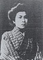 a black and white photograph of Noe Ito, wearing a robe and her hair back