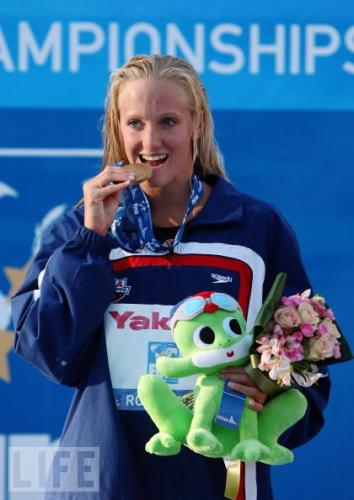 Vollmer, biting her bronze medal