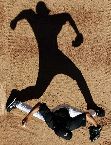 Silhouette of baseball pitcher