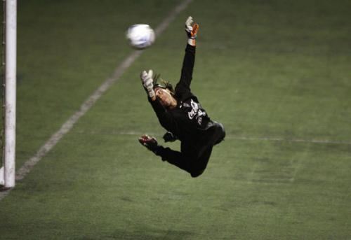 Goalkeeper dives
