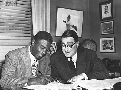 Jackie Robinson signs with Branch Rickey