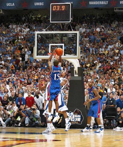 Mario Chalmers goes up for a game-tying three-pointer with time running out in regular against Memphis. Kansas would go on to win the 2008 game in overtime.