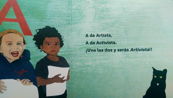 "The first page of the book reads ""A de Artista, A de Activista."""
